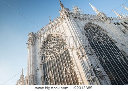 Gothic building with statues against blue sky