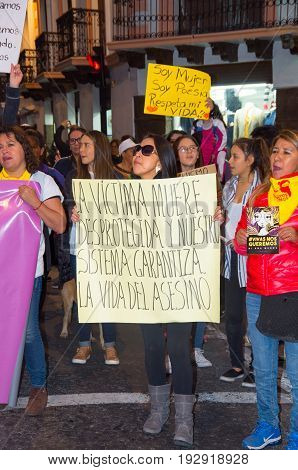 QUITO, ECUADOR- MAY 06, 2017: Unidentified group of women holding banners sign during a protest against the femicide in Quito Ecuador.