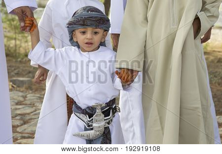 Nizwa Oman - June 26th 2017: omani kid dressed for Eid al Fitr day that is celebrated at the end of Holy month of Ramadan