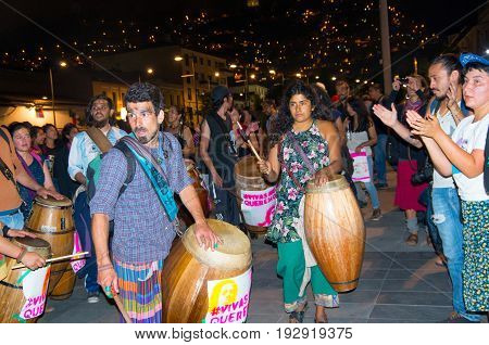 QUITO, ECUADOR- MAY 06, 2017: Group of artist with wooden drums in a protest with the slogan alive we want them, protest against the femicide in Quito Ecuador.