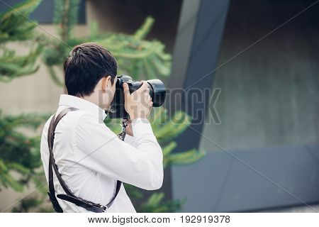 Wedding photographer takes pictures in nature in summer