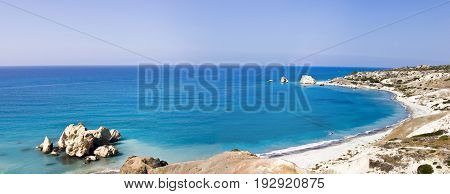 Paradise beach with azure water near Aphrodite's Rocks in Cyprus