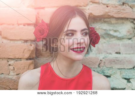 Woman Smiling With Dental Braces On Teeth