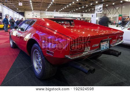 MAASTRICHT NETHERLANDS - JANUARY 14 2016: Sports car De Tomaso Pantera. Rear view. International Exhibition InterClassics & Topmobiel 2016