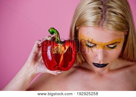 Bell Pepper In Hand Of Woman With Creative Fashionable Makeup
