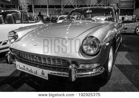 MAASTRICHT NETHERLANDS - JANUARY 14 2016: Sports car Ferrari 330 GT 2+2 Series II 1967. Black and white. International Exhibition InterClassics & Topmobiel 2016