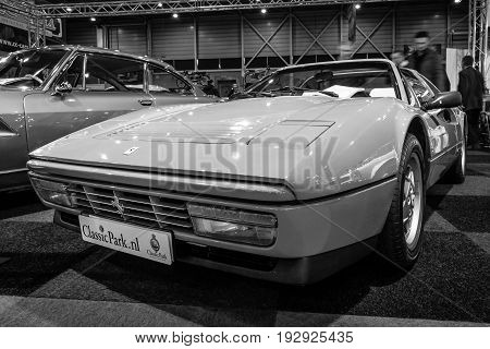 MAASTRICHT NETHERLANDS - JANUARY 14 2016: Sports car Ferrari 328 GTS (Gran Turismo Spider) 1989. Black and white. International Exhibition InterClassics & Topmobiel 2016