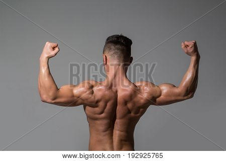 Biceps And Triceps Of Athlete With Muscular Body
