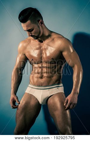 Muscular Man With Muscle Torso In Studio, Sport And Training