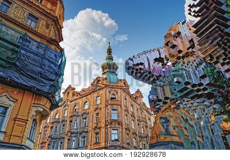 PRAGUE CZECH REPUBLIC - AUGUST 8 2015: City architecture of Prague old town with In Utero Sculpture by David Cerny