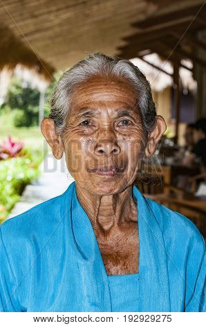 Ubud Indonesia - July 28 2013. An unidentified Balinese rice very old farmer poses during a morning's work near Ubud