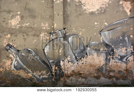 Street art. Glass jars and bottles on the wall background