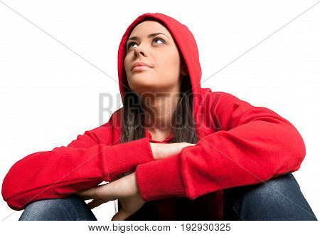 Beautiful girl sitting casual red white background