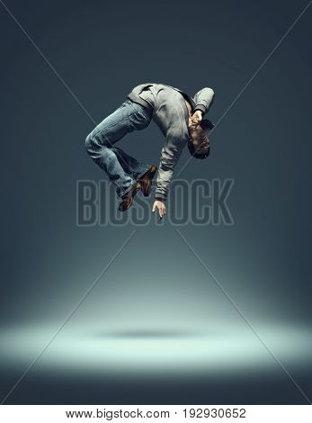 Hip hop dancer jumping and performing some of his dance. This is a 3d render illustration