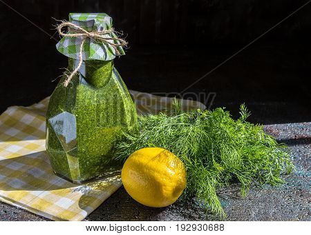 Dill sauce lemon and dill on a dark background.