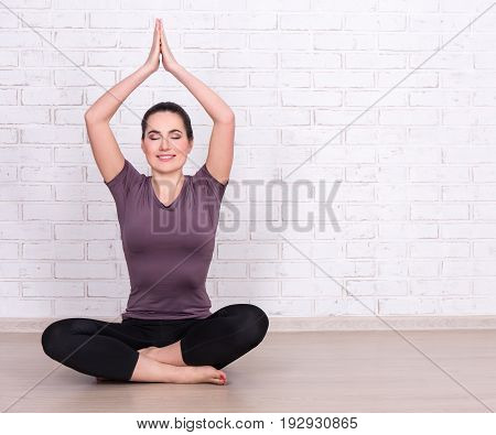 Slim Sporty Woman And Space Over White Brick Wall