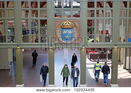 GOTHENBURG SWEDEN - MAY 2017: Interior of Gothenburg Central Train Station with Coat of Arm in a glass wall.