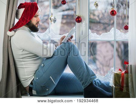 Young santa man hat wear wearing red
