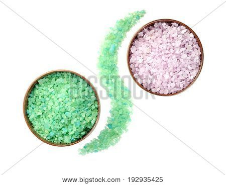 Aromatic natural mineral salt in wooden bowls , on a white background