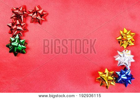 Colorful ribbons on a red fabric background
