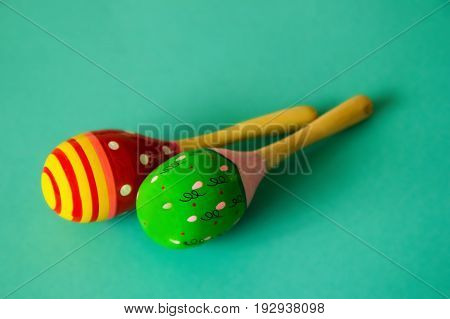 Green And Red Maracas On The Blue Background.