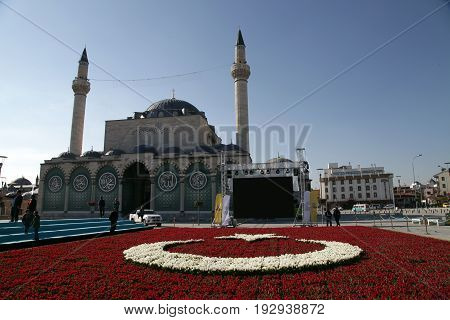 Konya, Turkey - April 14, 2017 : The Turkish Flag which was made of tulips and Sultan Selim Mosque in Konya, Turkey