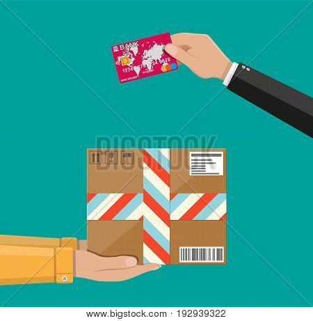 Hands with postal cardboard box and bank card. Delivery concept. Flat style vector illustration