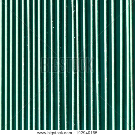 Metallic fence painted with green paint as a background .