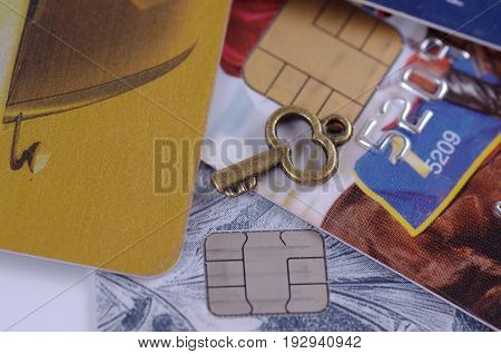Set of plastic payment card with little vintage key. Abstract financial background.