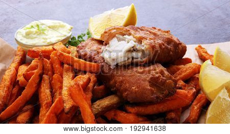 Traditional British Fish And Chips On Brown Paper