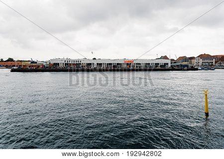 Copenhagen Denmark - August 12 2016: Papiroen Copenhagen Street food market and waterfront a cloudy day of summer