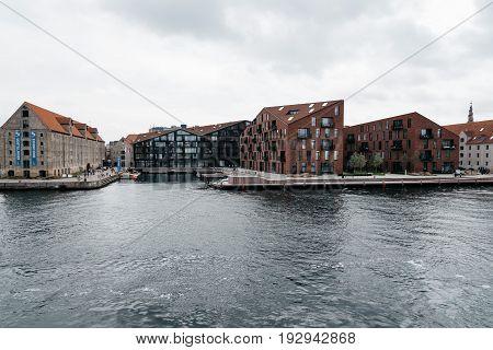 Copenhagen Denmark - August 12 2016: Waterfront of Copenhagen with modern residential buildings