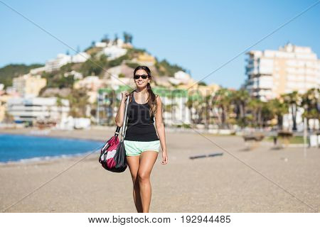 Young Pretty Woman Walking On Beach Smiling