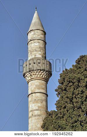 Turkish minaret in city of Kos in Greece
