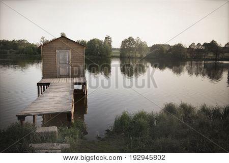 Old lake pier depressive background broken dreams