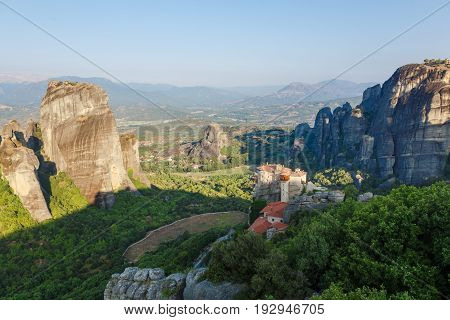Sunlight over monastery Roussanou in the morning on top of the mountain, Meteora, Greece.