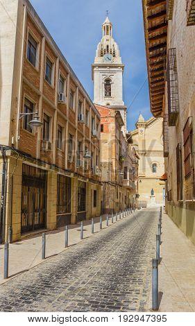 Cobblestoned Street Leading To The Santa Maria Church In Xativa