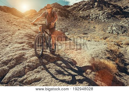 Bike traveler rides on mountain race .