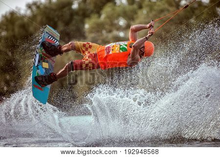 Extreme jumps on the board on the water. A lot of splashes and splashes of water.
