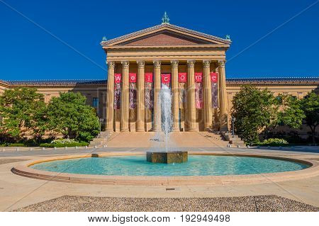 PHILADELPHIA, USA - NOVEMBER 22, 2016: The Philadelphia Pennsylvania Museum of Art East entrance and North wing buildings and empty main plaza with Greek revival style facade, with a beautiful fountain in front.