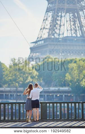 Couple Looking At The Eiffel Tower