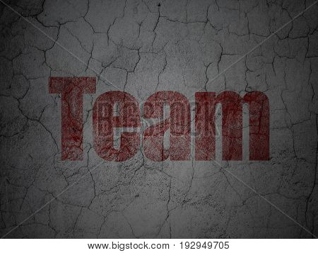 Finance concept: Red Team on grunge textured concrete wall background