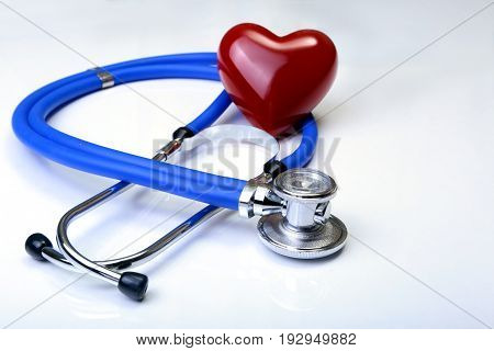 Red heart and a stethoscope isolated on white background