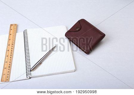 Folder file, note and wallet on the desk. blurred background