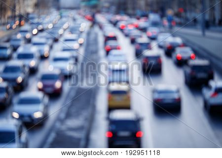 Defocused photo of city roads with moving cars