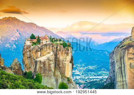 Beautiful landscape at sunrise with traditional mountain and Holy Trinity monastery in Meteora place Greece Europe