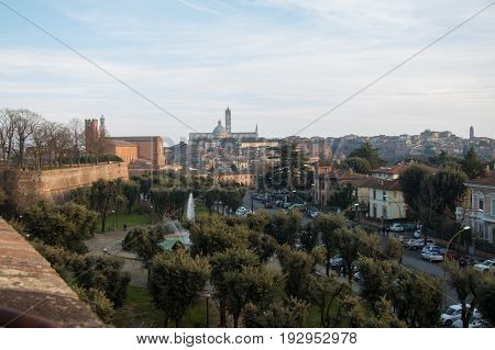 Italy Siena - December 26 2016: the view of the public park near Medici fortress and Duomo di Siena on background on December 26 2016 in Siena Tuscany Italy.