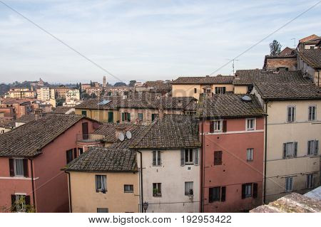 Italy Siena - December 26 2016: the view of old colorful narrow building in Siena on December 26 2016 in Siena Tuscany Italy.