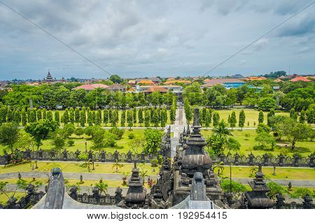 BALI, INDONESIA - MARCH 08, 2017: Panoramic landscape traditional balinese hindu temple Bajra Sandhi monument in Denpasar, Bali, Indonesia on background tropical nature and blue summer sky, Indonesia.