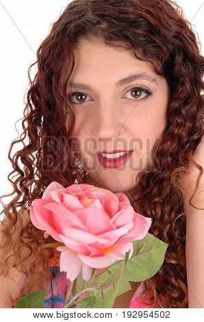 A closeup image of the face of a beautiful woman holding a pink rose with big eyes isolated for white background.
